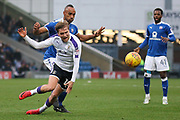 Chesterfield forward Chris O'Grady challenges Luton Town midfielder Luke Berry for the ball during the EFL Sky Bet League 2 match between Chesterfield and Luton Town at the Proact stadium, Chesterfield, England on 13 January 2018. Photo by Aaron  Lupton.