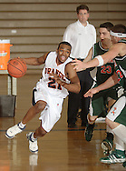 Middletownl, NY - Stephen Green of SUNY Orange drives to the basket in a Mid-Hudson Conference men's basketball game against Rockland Community College in Middletown on Feb. 26, 2008.
