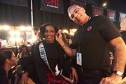 December 8, 2019, Atlanta, Georgia, USA: Serafina Nchama, Miss Equatorial Guinea 2019 gets makeup done by an OP Cosmetics artist backstage during The Miss Universe Competition telecast, held at Tyler Perry Studios. Contestants from around the globe have spent the last few weeks touring, filming, rehearsing and preparing to compete for the Miss Universe crown. (Credit Image: © Benjamin Askinas/Miss Universe Organization via ZUMA Wire)