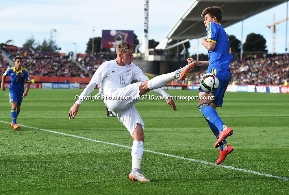Monty Patterson and Ukraine's Eduard Sobol during the FIFA U20 World Cup match, New Zealand Junior All Whites v Ukraine. North Harbour Stadium, Auckland, New Zealand. Saturday 30 May 2015. Copyright Photo: Andrew Cornaga / www.photosport.co.nz