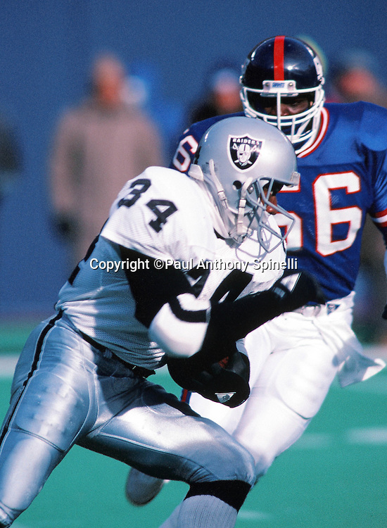 New York Giants linebacker Lawrence Taylor (56) chases Los Angeles Raiders running back Bo Jackson (34) during the NFL football game against the Los Angeles Raiders on Dec. 24, 1989 in East Rutherford, N.J. The Giants won the game 34-17. (©Paul Anthony Spinelli)