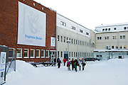 A group of school children walking out of their school in Sweden into the snow. The school is The Internationella Engelska Skolan in Gavle.