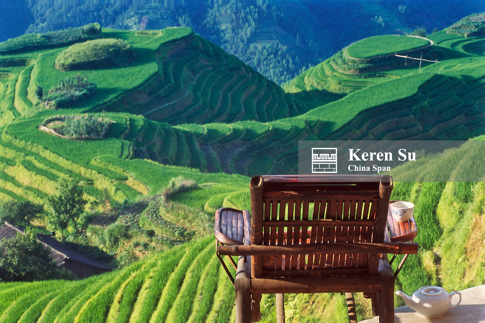 A bamboo chair overlooking terraced rice paddies in the mountain, Longsheng, Guangxi Province, China