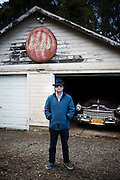 """Napa Valley, April 5 2012 - Roman Coppola posing in front of the 49 Hudson car used in the movie """"On the Road"""" by Walter Salles."""