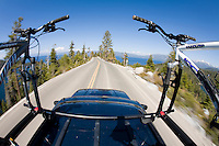 Blurred image of mountain bikes on roof rack near Lake Tahoe, CA.