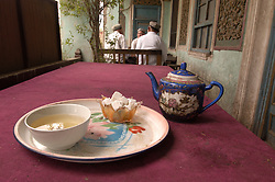 Detail of teapot and sweets ain  muslim teahouse in Kashgar China