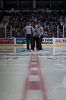 KELOWNA, CANADA - DECEMBER 27: Ice officials stand at centre ice before puck drop between Kelowna Rockets and the Kamloops Blazers on December 27, 2017 at Prospera Place in Kelowna, British Columbia, Canada.  (Photo by Marissa Baecker/Shoot the Breeze)  *** Local Caption ***