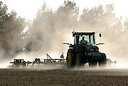 Israel, Negev Desert, Tractor ploughs a field