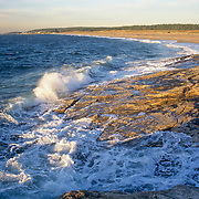 Waves breaking on the rocks at high tide on the beach at Reid State Park. Georgetown, Maine