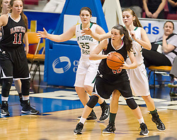 Bluefield guard Alyssa Lester (20) looks to pass against Wyoming East during a first round game at the Charleston Civic Center.