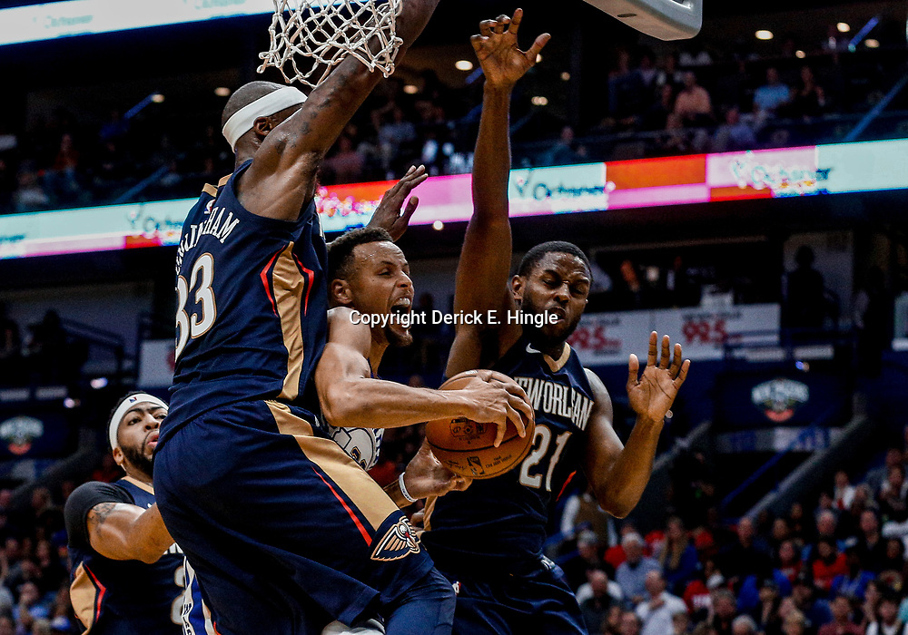 Oct 20, 2017; New Orleans, LA, USA; Golden State Warriors guard Stephen Curry (30) draws a foul under the basket from New Orleans Pelicans forward Dante Cunningham (33) as forward Darius Miller (21) defends during the second quarter of a game at the Smoothie King Center. Mandatory Credit: Derick E. Hingle-USA TODAY Sports