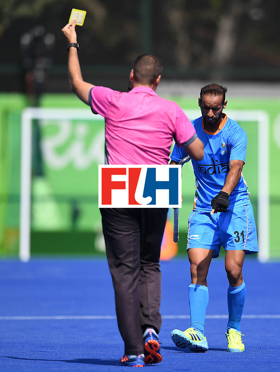 India's Ramandeep Singh speaks with the referee during the men's field hockey India vs Ireland match of the Rio 2016 Olympics Games at the Olympic Hockey Centre in Rio de Janeiro on August, 6 2016. / AFP / MANAN VATSYAYANA        (Photo credit should read MANAN VATSYAYANA/AFP/Getty Images)