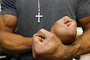 A Christian prisoner shows his muscles and fists at Wandsworth prison in London..HMP Wandsworth in South West London was built in 1851 and is one of the largest prisons in Western Europe. It has a capacity of 1456 prisoners.