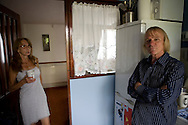 Jim and his wife Lauren in their prefab at the Excalibur Estate. They have been living here for 20 years and are fighting to save it as the Lewisham Council want to pull the prefabs down. Thousands of post-war prefabs are still being lived in and cherished by their tenants or owners all over the UK.