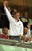 Photo: Richard Lane.<br />England v Wales.  Quarter-Final 2, at the Suncorp Stadium, Brisbane. RWC 2003. 09/11/2003.<br />Prince Harry celebrates England points.