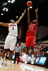 Nov 14, 2011; Stanford CA, USA;  Fresno State Bulldogs forward Kevin Foster (24) shoots over Stanford Cardinal guard/forward Anthony Brown (3) during the first half of a preseason NIT game at Maples Pavilion. Mandatory Credit: Jason O. Watson-US PRESSWIRE