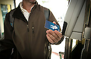 A passenger pays with a Clipper Card on a Muni Streetcar | March 19, 2013