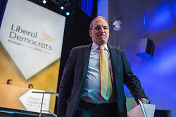 © Licensed to London News Pictures . 04/10/2014 . Glasgow , UK . SIMON HUGHES , Minister of State at the Ministry of Justice , leaves the stage after delivering his speech to the conference . The Liberal Democrat Party Conference 2014 at the Scottish Exhibition and Conference Centre in Glasgow . Photo credit : Joel Goodman/LNP