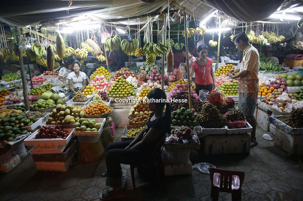 SIEM REAP, NOVEMBER-27: a fruit vendor waits for customers at a night market in Siem Reap, November 26,2006, Cambodia . One of the world's poorest countries, the majority of Cambodia's population (about 74%) is employed in agriculture...