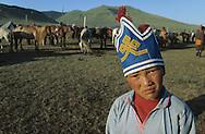 Mongolia. Kid's horse race; naadam of Oulan Bator The headdress of the competitors   /  Les jeunes cavaliers portent des coiffes ornées ( courses du Nadaam de Oulan Bator)   4     /  P0000521