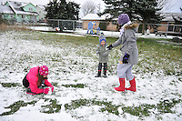 Wyatt Waite (boy) Grace Waite (oldest girl purple hat) Maggie Wait (youngest girl turqoise hat) and Isabel Waite (Pink hat) all take advantage of the first snow of the season in Oak Harbor Friday. Photo by Michael Watkins/Whidbey News-Times