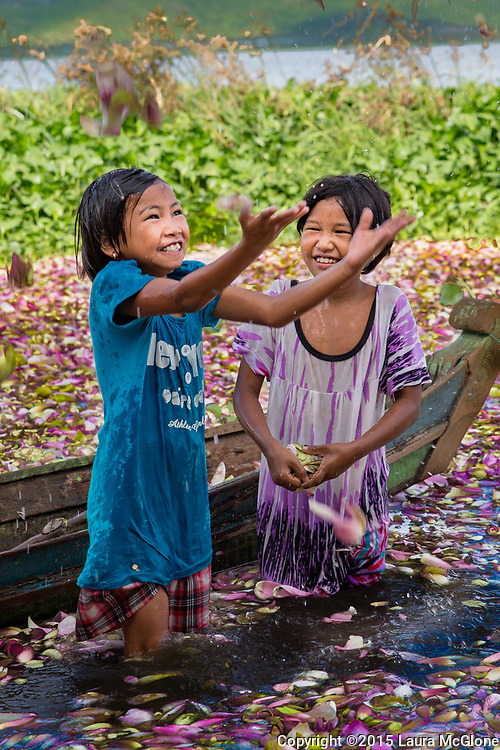 Children play in Lotus Flower Lake, Myanmar