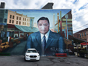 A police car is parked in front of the Frank Rizzo mural Saturday morning after it was vandalized in South Philadelphia. DAVID SWANSON / Staff Photographer