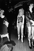 Three girls in New Romantic styles, Camden Palace, Posers, London, UK, 1980's.