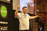 Mensur Suljovic takes to the stage ahead of the First Round of the BetVictor World Matchplay Darts at the Empress Ballroom, Blackpool, United Kingdom on 19 July 2015. Photo by Shane Healey.