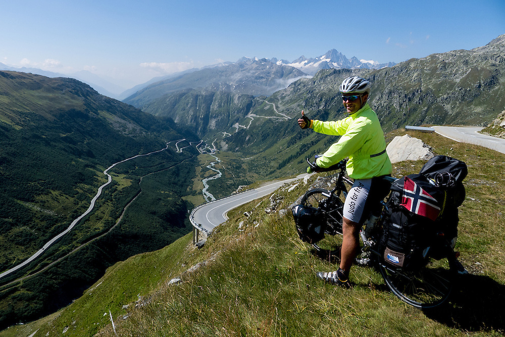 A cyclist is ready for biking down the Furka pass(2429 msl) and up the Grimsel pass (2165 msl)!!!