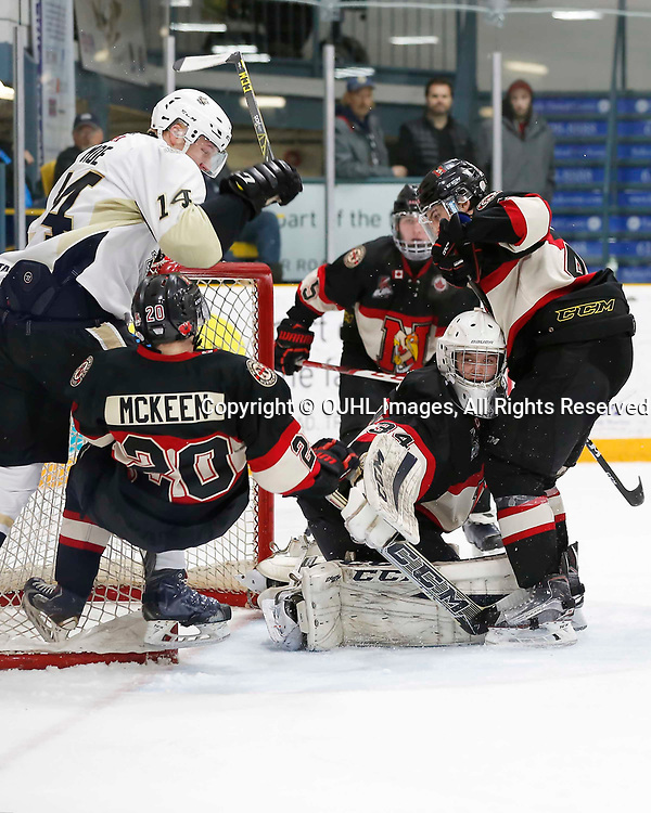 TRENTON, ON - MAR 7,  2017: Ontario Junior Hockey League, playoff game between the Trenton Golden Hawks and the Newmarket Hurricanes., Chalmers McKeen #20 of the Newmarket Hurricanes takes the hit from Rex Moe #14 of the Trenton Golden Hawks<br /> (Photo by Amy Deroche / OJHL Images)