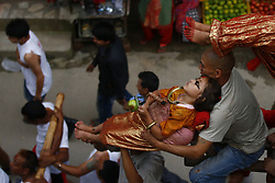 July 6, 2018 - Kathmandu, Nepal - Nepalese children maintain balance on the tip of a prong implanted in a chariot during the Trishul festival in Kathmandu. The Trishul Jatra chariot is toured throughout the ancient city with children carried between the spikes of Trishul, the weapon of Lord Shiva. It is one of the oldest festivals of Newar community. (Credit Image: © Skanda Gautam via ZUMA Wire)