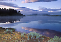 Reflections and fog over Steamboat Lake State park, Colorado.  Photo taken Prior to the pine beetle infestation.