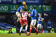 Matt Clarke (5) of Portsmouth has his hands on the shoulders of John Marquis (9) of Doncaster Rovers to help head the ball during the EFL Sky Bet League 1 match between Portsmouth and Doncaster Rovers at Fratton Park, Portsmouth, England on 3 February 2018. Picture by Graham Hunt.