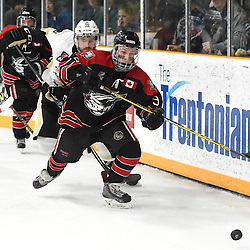 TRENTON, ON - Apr 18, 2016 -  Ontario Junior Hockey League game action between the against the Trenton Golden Hawks and the Georgetown Raiders. Game 3 of the Buckland Cup Championship Series, at the Duncan Memorial Gardens in Trenton, Ontario. Jordan Crocker #9 of the Georgetown Raiders and Blayne Oliver #16 of the Trenton Golden Hawks pursue the play during the third period.<br /> (Photo by Andy Corneau / OJHL Images)