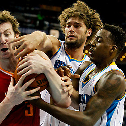 Jan 9, 2013; New Orleans, LA, USA; Houston Rockets center Omer Asik (3) fights for possession of the ball with New Orleans Hornets center Robin Lopez (15) and small forward Al-Farouq Aminu (0) during the fourth quarter of a game at the New Orleans Arena. The Hornets defeated the Rockets 88-79. Mandatory Credit: Derick E. Hingle-USA TODAY Sports