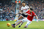 Barnsley midfielder Adam Hammill (7) wins the ball with a sliding tackle on Fulham defender Ryan Fredericks (2) during the EFL Sky Bet Championship match between Fulham and Barnsley at Craven Cottage, London, England on 14 January 2017. Photo by Andy Walter.
