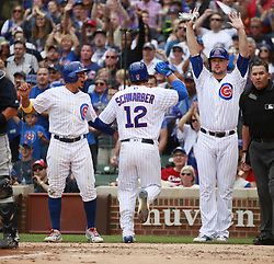 September 2, 2017 - Chicago, IL, USA - From left, the Chicago Cubs' Jon Jay, Kyle Schwarber, and Jon Lester after they scored on a triple by Anthony Rizzo against the Atlanta Braves during the fourth inning at Wrigley Field in Chicago on Saturday Sept., 2, 2017. (Credit Image: © Nuccio Dinuzzo/TNS via ZUMA Wire)