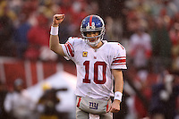 Eli Manning #10 of the New York Giants celebrates after scoring a touchdown against the San Francisco 49ers during the NFC championship game at Candlestick Park in San Francisco, California, USA 22 Jan 2012..The Giants defeated the 49ers 20-17. (Photo by Jed Jacobsohn)....