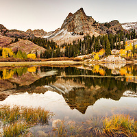 Lake Blanche reflects the fall foliage and Sundial Peak in the Wasatch.