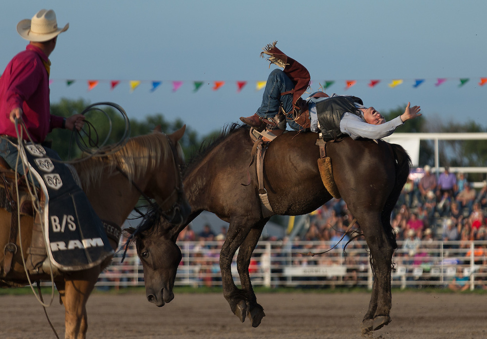 Frank Morton of Wright Kansas competes in bareback riding at Nebraska's Big Rodeo on Saturday, July 30, 2016, in Burwell.