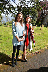 Left to right, INDIA LANGTON and VIOLET VON WESTENHOLZ and  at the wedding of Princess Florence von Preussen second daughter of Prince Nicholas von Preussen to the Hon.James Tollemache youngest son of the 5th Lord Tollemache held at the Church of St.Michael & All Angels, East Coker, Somerset on 10th May 2014.