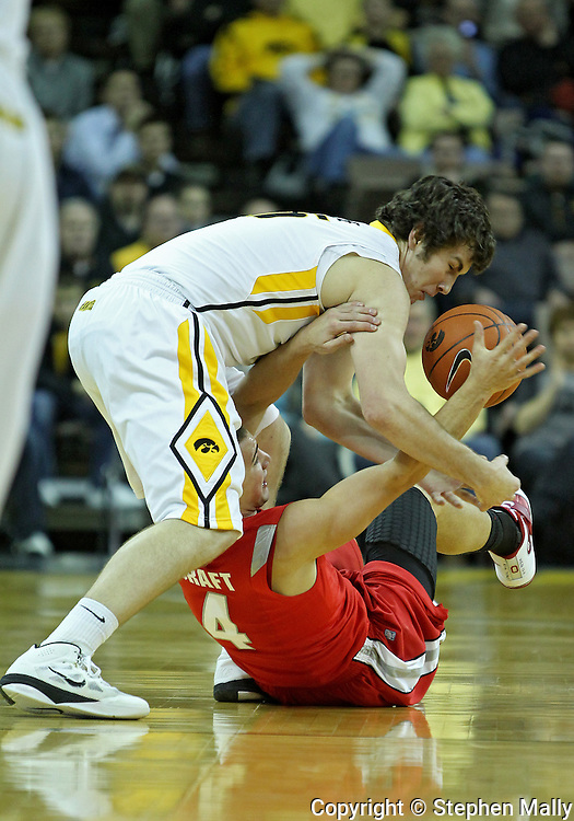 January 04 2010: Iowa Hawkeyes forward Zach McCabe (15) and Ohio State Buckeyes guard Aaron Craft (4) battle for a lose ball during the first half of an NCAA college basketball game at Carver-Hawkeye Arena in Iowa City, Iowa on January 04, 2010. Ohio State defeated Iowa 73-68.