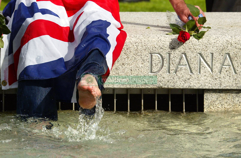 John Loughrey from Wandsworth,London, splashes around in the Diana Fountain as it reopens to the public after safety modifications.