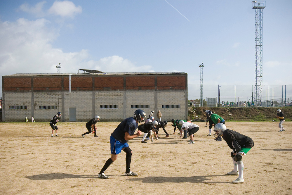 (Santiago de Compostela, Spain - November 8, 2009) - The Galicia Black Towers practice on an old, decrepit soccer field on Sundays just outside of Santiago de Compostela. The team of about 20 members from Santiago and nearby A Coruña gets the field and facilities for free..Photo by Will Nunnally / Will Nunnally Photography