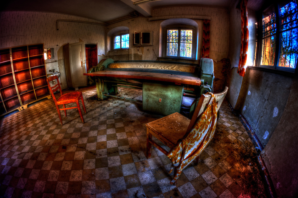Old room interior with tatty chairs