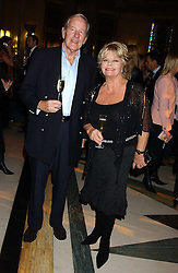 TV presenter JUDITH CHALMERS and her husband MR NEIL DURDEN-SMITH at the 2005 Lancome Colour Design Awards in association with CLIC Sargent Cancer Care for Children held at the Freemasons' Hall, Great Queen Street, London on 23rd November 2005.<br />