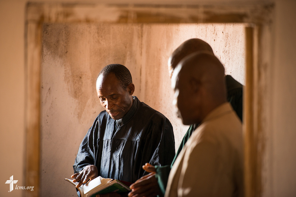 The Rev. Humphrey Nyirenda, central diocese pastor of the Confessional Lutheran Church–Malawi Synod, joins fellow pastors in preparation for worship on Sunday, Sept. 27, 2015, in Chingale, Malawi. LCMS Communications/Erik M. Lunsford