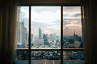 A cityscape of Bangkok, Thailand through a hotel window.