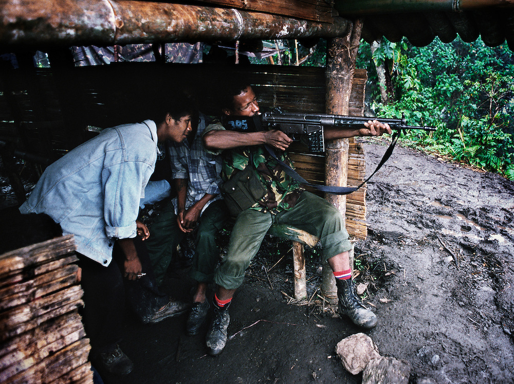 Veteran Falintil soldier instructing students.<br /> <br /> Many younger East Timorese who are Falintil supporters frequently visit the various camps, sometimes acting as couriers and porters.<br /> <br /> East Timor, March 1999.